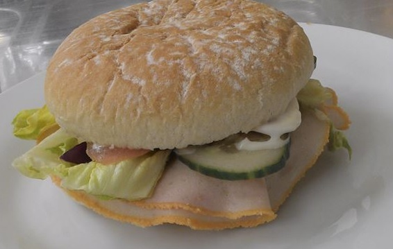 """A Breaded ham bap with salad of your choice added"""
